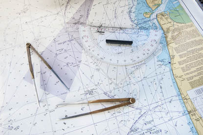 Chart of the North Sea with 2 pairs of compasses and a plotter.